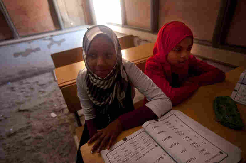 An English class in the Tawargha refugee camp. Students here are studying a new history textbook that makes almost no mention of Gadhafi.