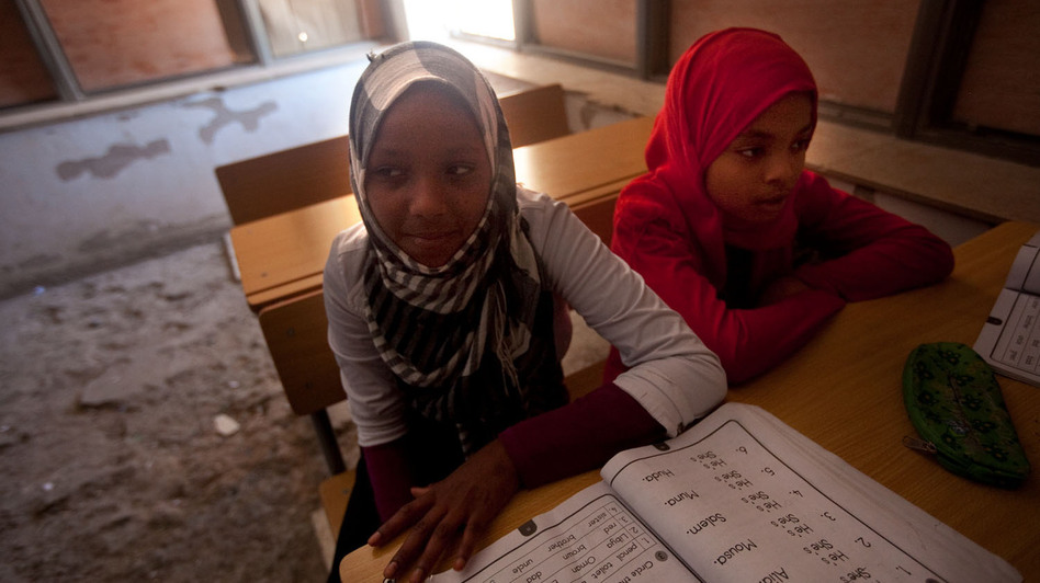 An English class in the Tawargha refugee camp. Students here are studying a new history textbook that makes almost no mention of Gadhafi. (NPR)