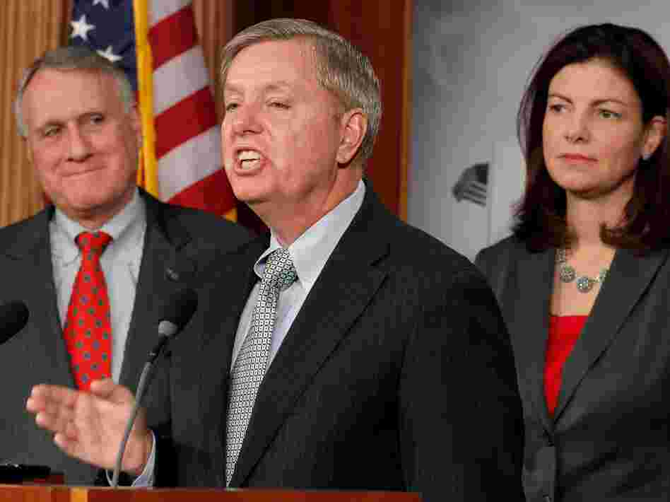 Sens. Jon Kyl, R-Ariz, Lindsey Graham, R-S.C., and Kelly Ayotte, R-NH, hold a news conference in Washington, D.C. Graham has criticized President Obama for his handling of intelligence leaks.