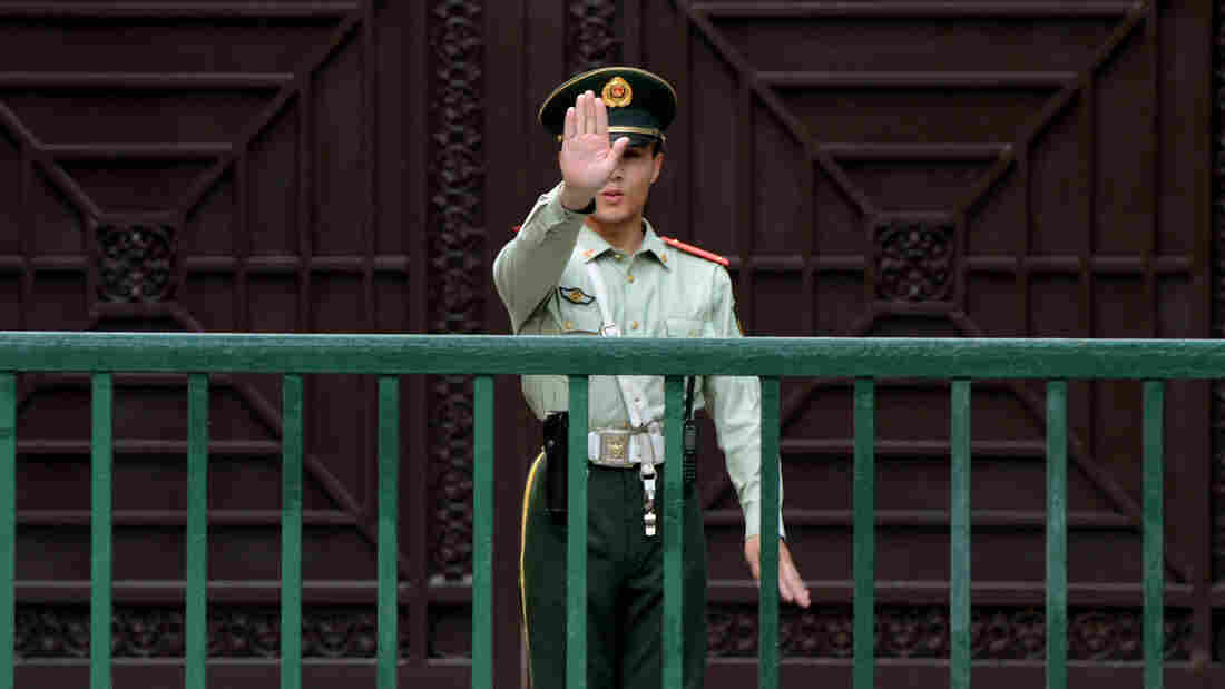 A Chinese paramilitary guard gestures outside the North Korean Embassy in Beijing on May 17. Tensions between the two countries are rising after unidentified North Koreans hijacked three Chinese fishing boats and demanded ransom, before releasing the vessels and their crew.