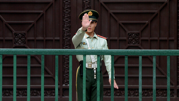 A Chinese paramilitary guard gestures outside the North Korean Embassy in Beijing on May 17. Tensions between the two countries are rising after unidentified North Koreans hijack