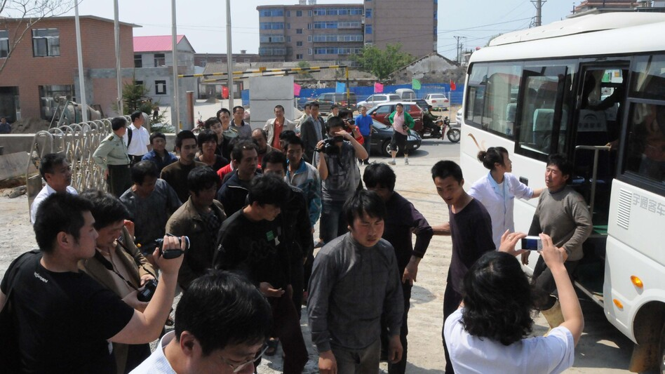 Chinese fishermen — detained for 13 days by North Korea — return to Dalian, in northeast China's Liaoning province, May 21.