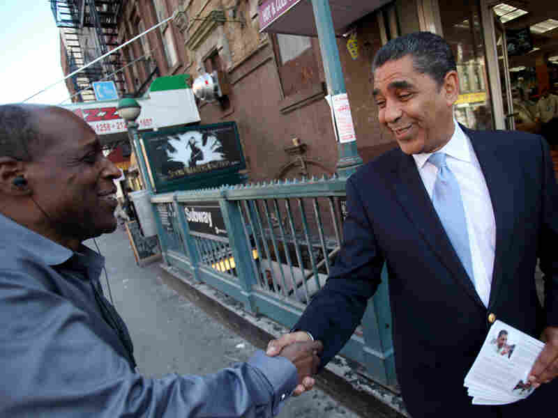 New York state Sen. Adriano Espaillat campaigns on the corner of 110th Street and Lexington Avenue in New York's Harlem in May. Espaillat is running for the incumbent Rangel's seat in what is now the 13th Congressional District.