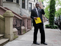 Clyde Williams takes a break from canvassing in Manhattan's Harlem neighborhood on May 3. Williams is also running for Rangel's seat.