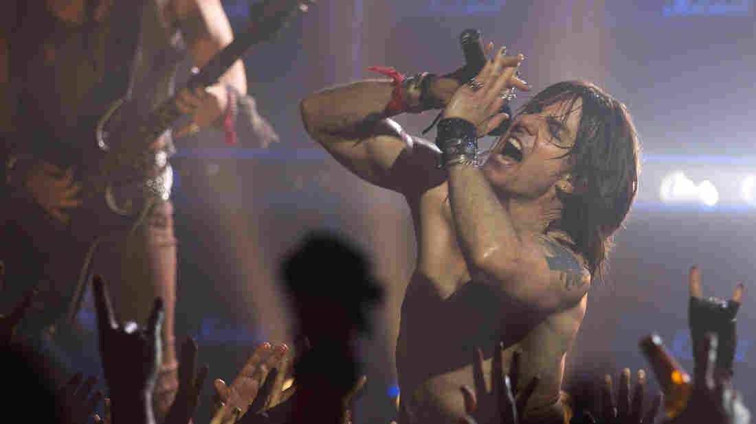 Tom Cruise plays Stacee Jaxx, an egomaniacal rock star, in Rock of Ages. The movie features several supporting performances — including ones from Alec Baldwin, Bryan Cranston and Catherine Zeta-Jones — that outshine the main plot.