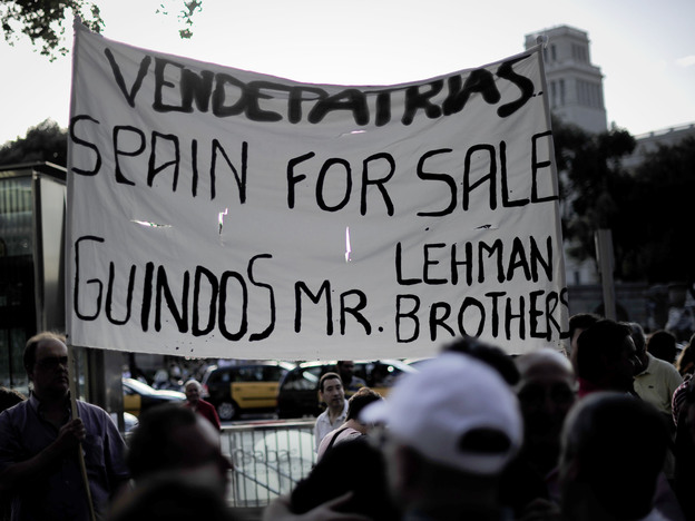 Protesters rally against a bailout package for Spain in front of a Bank of Spain building in Barcelona on Monday. The demonstrators think the bailout will bring only greater hardship.