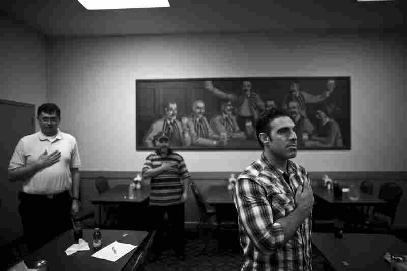 Blake (right) recites the Pledge of Allegiance at the start of a meeting of the Marine Corps Veterans Association in Sacramento, Calif. Blake joined the group to keep in touch with both old and young Marine veterans in the area who support one another.