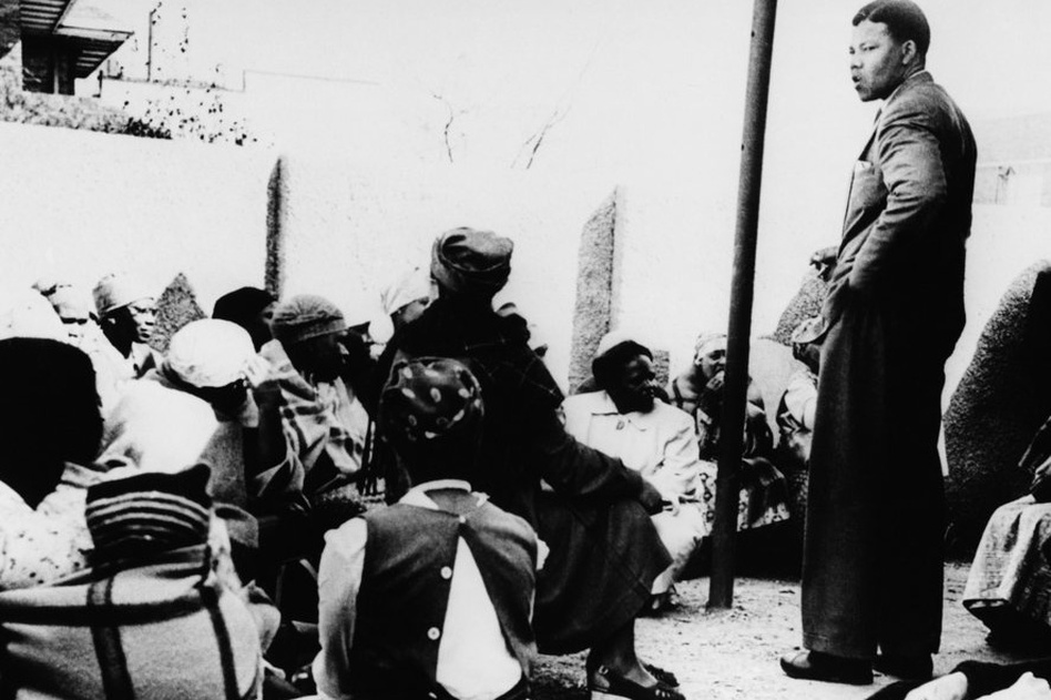 Mandela talks to a group of women demonstrating against the pass laws, which required black South Africans to carry identity documents, in 1959. (AP)