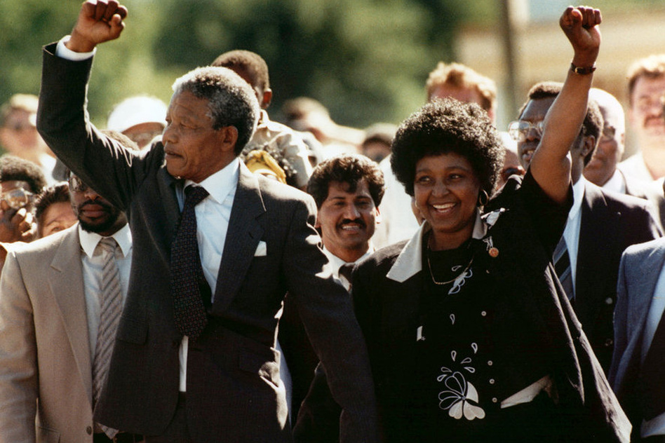Mandela and his second wife, Winnie, greet the crowd on Feb. 11, 1990, upon his release from Victor Verster prison. He served 27 years. (AP)