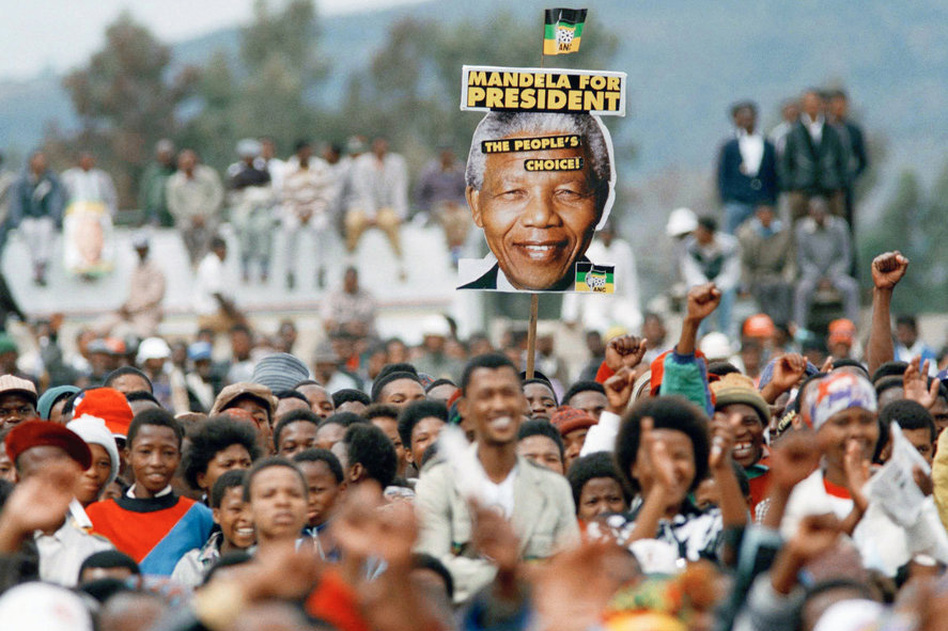 Mandela supporters cheer during an election rally in Thaba Nchu, South Africa, on April 21, 1994. (AP)
