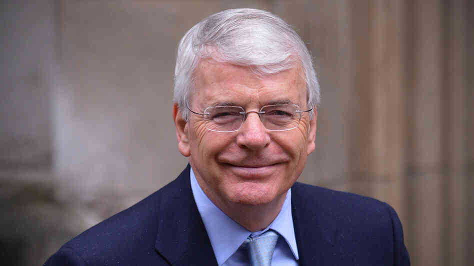 Former British Prime Minister John Major arrives to