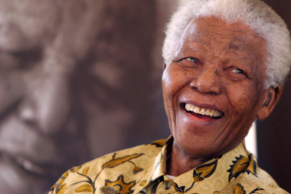 Former South African President Nelson Mandela, one of the world's most respected statesmen, died Thursday at 95. (Denis Farrell/AP)