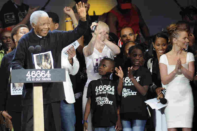 Mandela waves during a charity concert in honor of his 90th birthday, on June 27, 2008, in London.