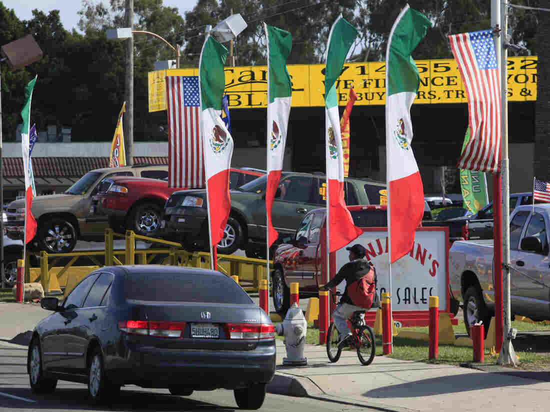 U.S. and Mexican flags decorate an auto shop in Santa Ana, Calif., June 2011.