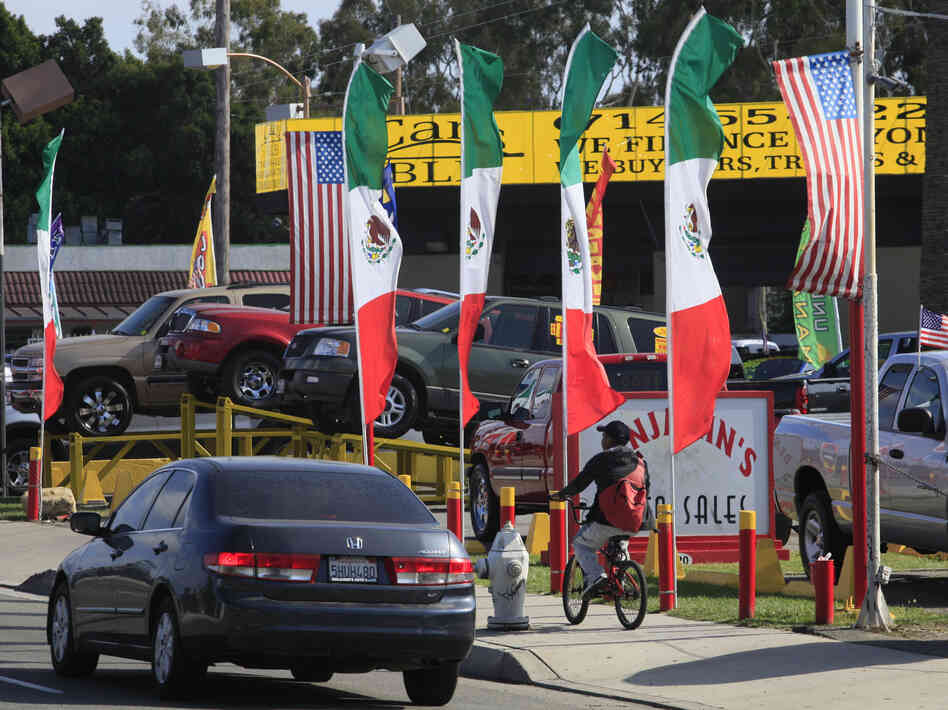 U.S. and Mexican flags decorate an auto shop in Santa Ana, Calif., Jun