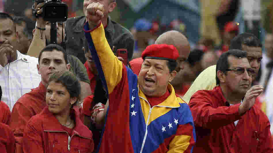 Venezuela's President Hugo Chavez arrives atop a truck at the elections office in Caracas on Monday. Chavez addressed thousands of supporters as he formalized his re-election bid. Chavez's younger daughter Rosines is by his side, and on his right is his brother Adan.