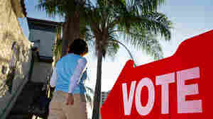 A Republican primary voter walks to her polling precinct in January in St. Petersburg, Fla.