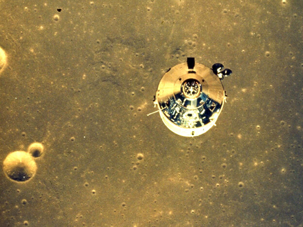The Apollo 11 space module above the surface of the moon.