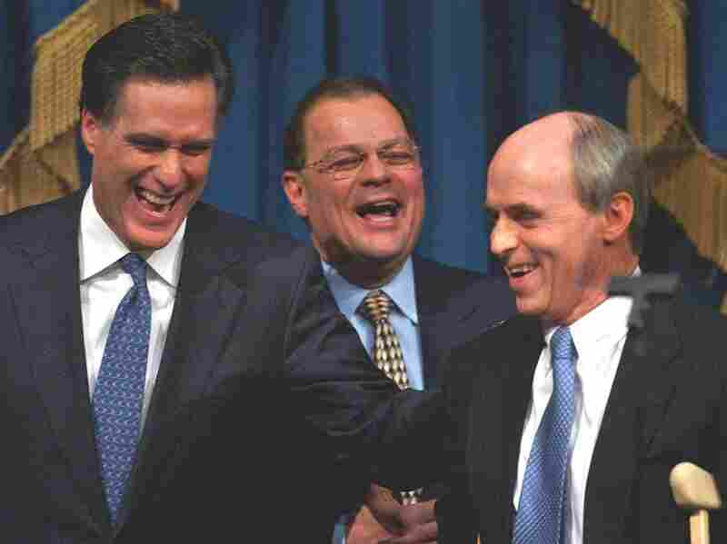 Romney shares a light moment with Senate President Robert E. Travaglini (center) and House Speaker Thomas Finneran before his State of the State address in 2004.