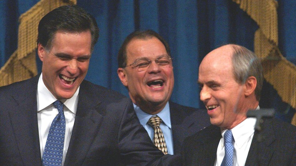 Romney shares a light moment with Senate President Robert E. Travaglini (center) and House Speaker Thomas Finneran before his State of the State address in 2004. (AP)