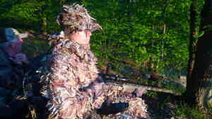 Jake Dobberke, 26, a Marine who lost his legs in Afghanistan, watches for turkeys in Potter County, Pa. The LEEK Hunting and Mountain Preserve helps healing young vets explore the wilderness in adaptive hunting gear.