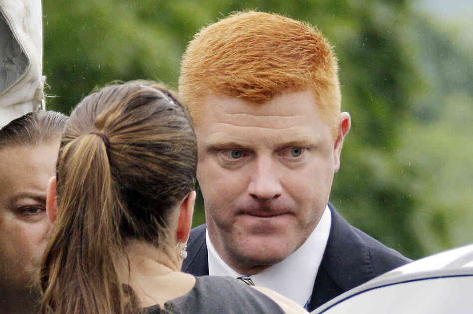 Penn State University assistant football coach Mike McQueary arrives at the Centre County Courthouse to testify in the child sexual abuse trial of former Penn State University assistant football coach