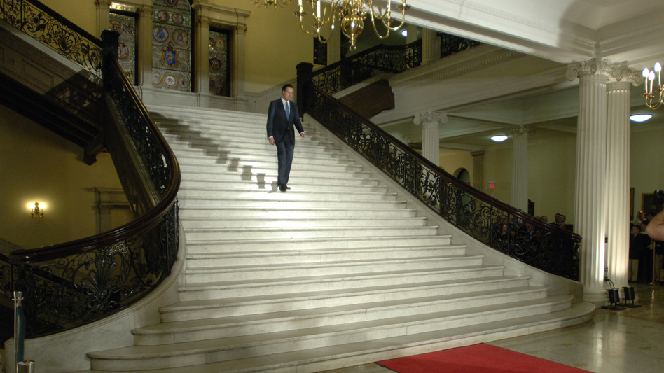 Romney walks down the central staircase inside the Statehouse during a ceremony marking the end of his term as governor on Jan. 3, 2007. (AP)
