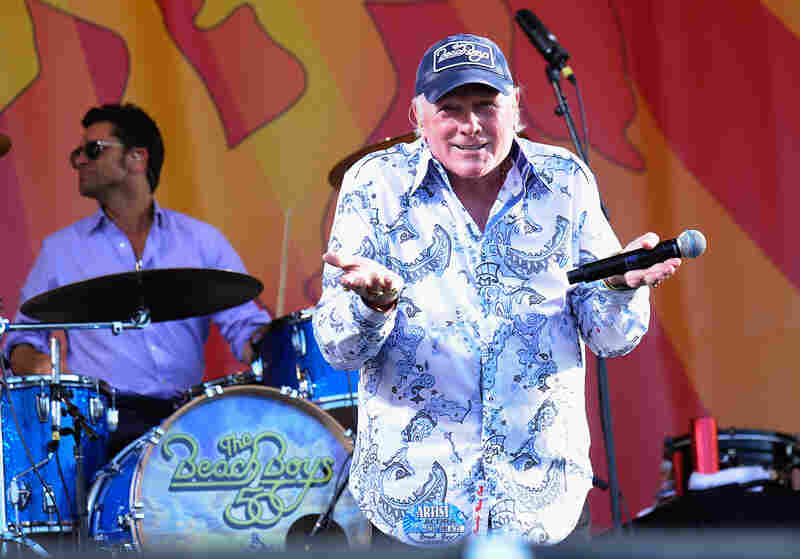 NEW ORLEANS, LA - APRIL 27: Actor John Stamos joins Mike Love of The Beach Boys on stage and performs during the 2012 New Orleans Jazz & Heritage Festival Presented by Shell at the Fair Grounds Race Course on April 27, 2012 in New Orleans, Louisiana. (Photo by Rick Diamond/Getty Images)