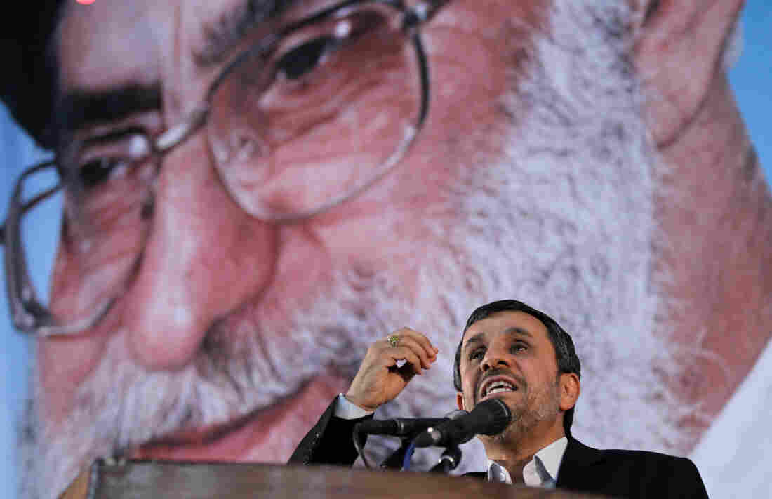 Iranian President Mahmoud Ahmadinejad delivers a speech under a portrait of Iran's supreme leader, Ayatollah Ali Khamenei, on June 2. The supreme leader has said repeatedly that nuclear weapons are un-Islamic and Iran will not pursue them. But in the West, many are skeptical.