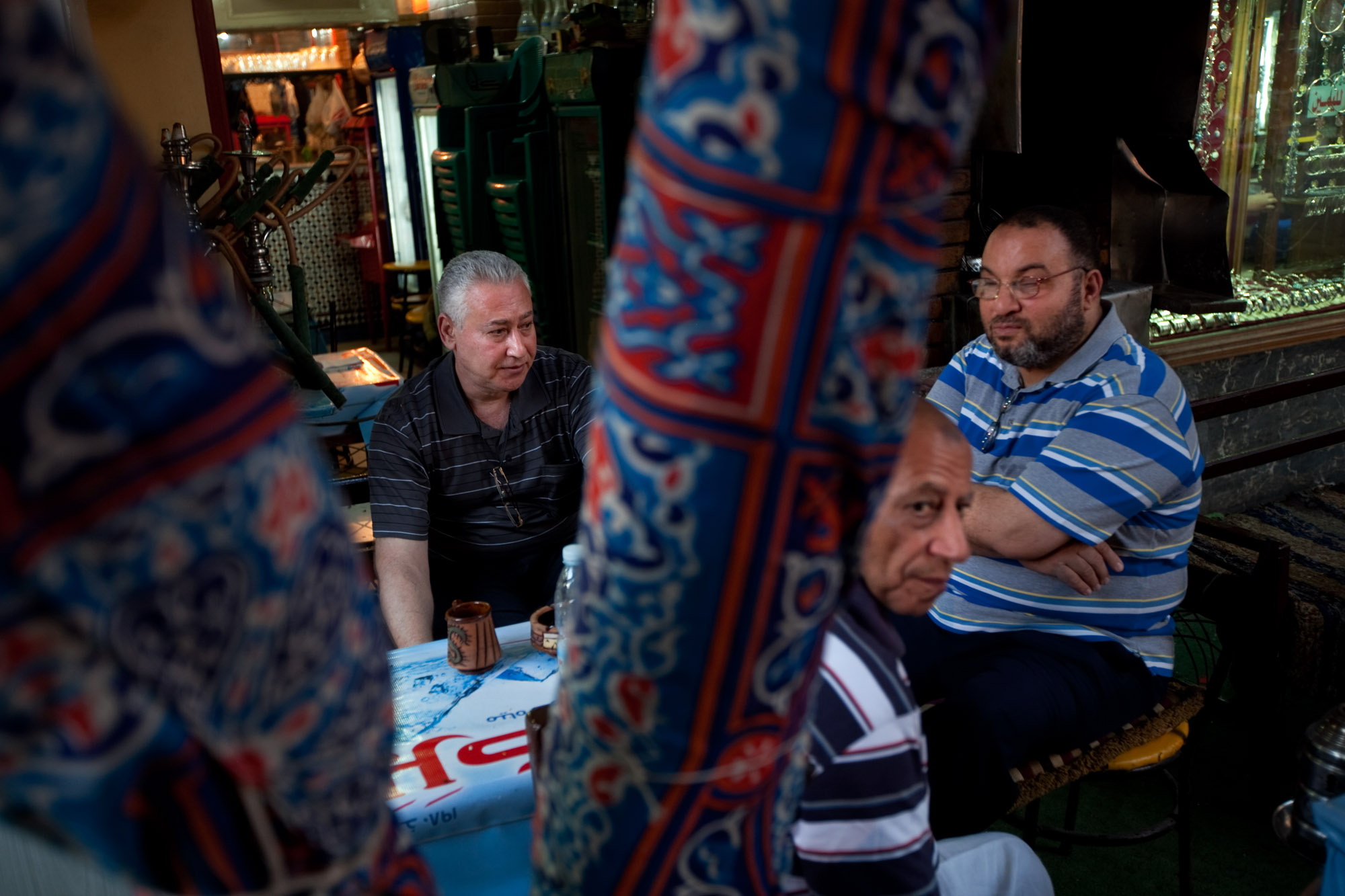 In the Khan el-Khalili market, cafe owner Hassan El Halwagy (left) thinks that Islamist groups are not qualified to run the country.