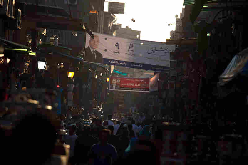 The Khan el-Khalili market in downtown Cairo. Election posters for the two candidates in Egypt's presidential runoff election are hanging above the street.