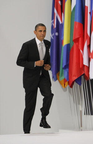 President Obama climbs the podium to give a media briefing at the end of a NATO summit in Lisbon, Portugal, on Nov. 20, 2010.
