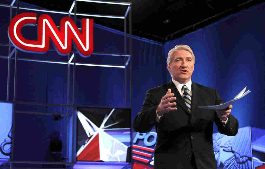 Moderator from CNN John King speaks to the crowd before a Republican presidential debate.