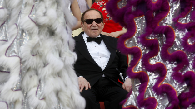 Las Vegas casino magnate Sheldon Adelson watches a performance at the Sands Cotai Central in Macau in April. (AP)