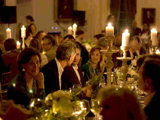 By paying to join the Garden & Gun club, members can attend events like a candlelight affair at the historic South Carolina Society Hall in Charleston as part of Garden & Gun's Secret Society Supper Club.