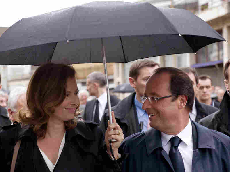 French President Francois Hollande (right) with his companion, Valerie Trierweiler, in Tulle, southwestern France, on June 9. Hollande campaigned as a down-to-earth politician, the opposite of his scandal-prone predecessor, Nicolas Sarkozy.