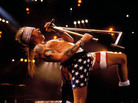 Axl Rose onstage. In American flag bike shorts.