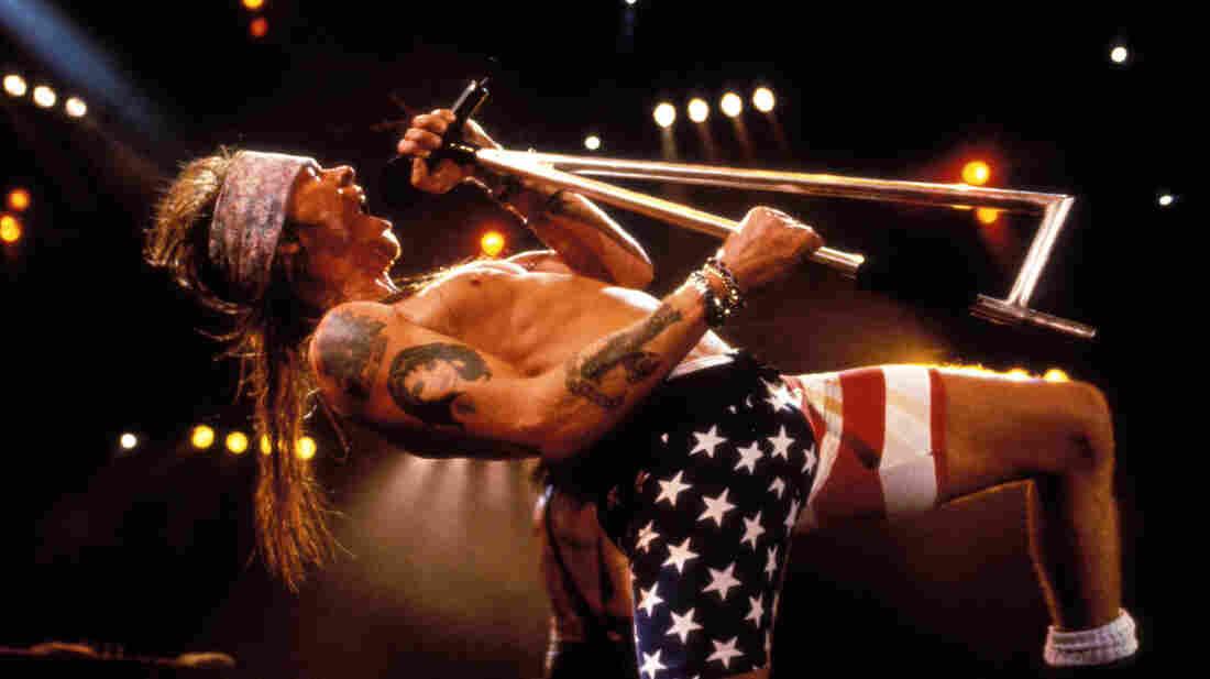 Axl Rose onstage. In American flag bike shorts.