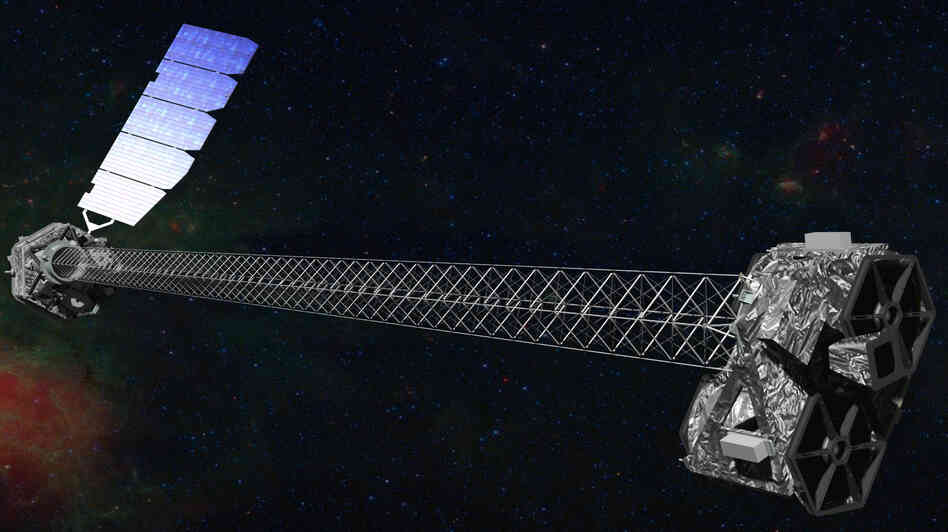 This artist's illustration shows what NuSTAR should look like in orbit after its 30-foot-long mast deployed.