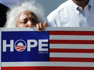 An elderly supporter of President Barack Obama joins others to cheer near a house where Obama held a campaign event in Los Angeles, California on June 7. Despite recent campaign gaffes by the President many have described as self-inflicted wounds, opinion polls