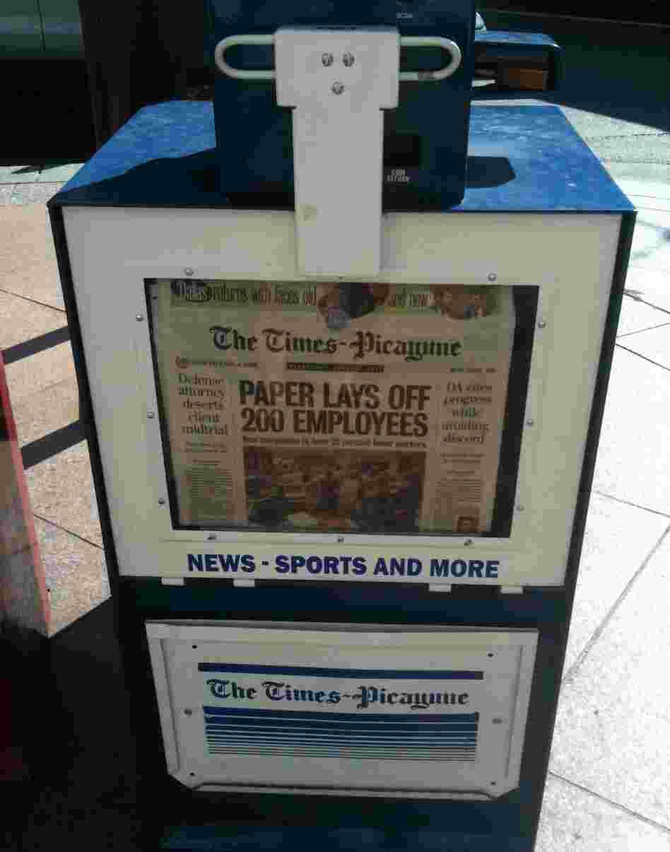 A New Orleans newspaper stand holds copies of Wednesday's Times-Picayune, which announced layoffs for 200 employees.