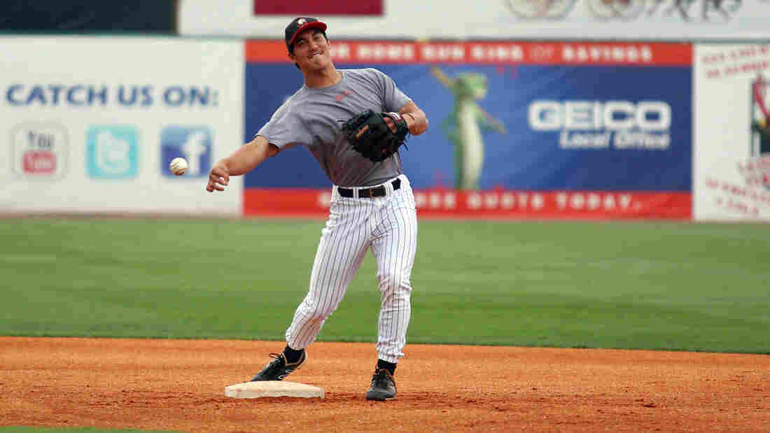 Tyler Saladino, 22, makes a throw from second base during warm-ups with the AA Birmingham Barons.