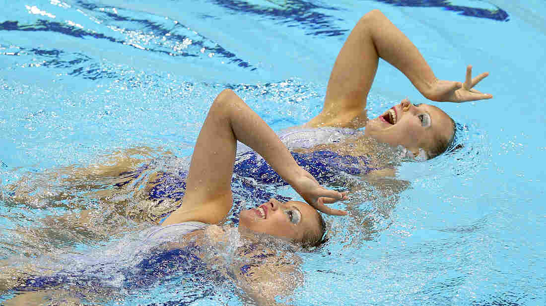Mary Killman and Mariya Koroleva of the U.S. compete in the Olympic qualifiers in April in London. They'll compete together in the Olympics this summer.