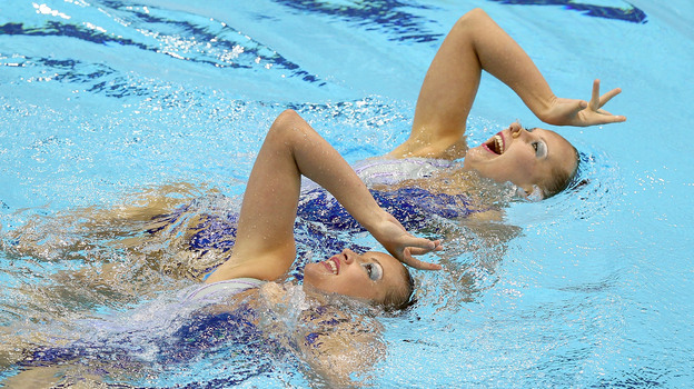 Mary Killman and Mariya Koroleva of the U.S. compete in the Olympic qualifiers in April in London. They'll compete together in the Olympics this summer. (Getty Images)