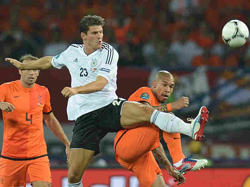 German forward Mario Gomez, left, vies with Dutch midfielder Nigel de Jong during the Euro 2012 football match Wednesday night. Mario Gomez scored two the two goals for Germany.