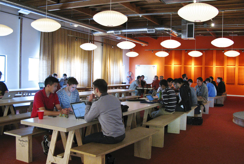 Tech entrepreneurs gather at the offices of Y Combinator, a company based in Mountain View, Calif., that provides seed money to young startups. Founder Paul Graham predicts half of the startups funded by Y Combinator will ultimately fail.
