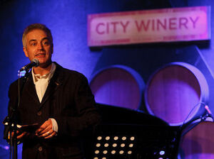 Host John Wesley Harding on the Cabinet of Wonders at City Winery in Brooklyn, NY.