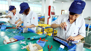 Workers assemble computers at a factory in Jiashan, east China's Zhejiang province.