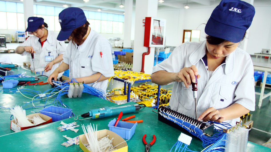 Workers assemble computers at a factory in Jiashan, east China's Zhejiang province. (AFP/Getty Images)