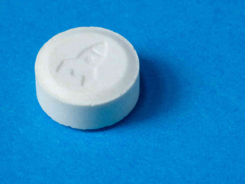 An ecstasy pill with a rocket shop imprint.